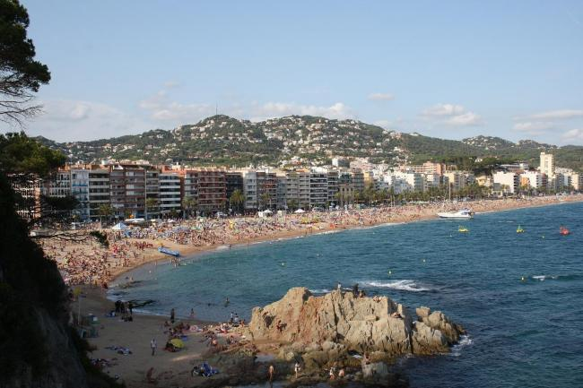 A teenager has died while on holiday in Spain