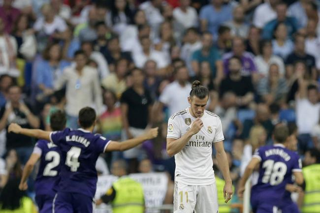 Real Madrid's Gareth Bale, centre, shows his disappointment as Real Valladolid celebrate