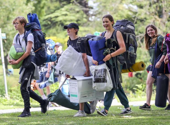 Festival goers walk along the towpath of the River Thames as they arrive for the Reading Festival at Richfield Avenue. PRESS ASSOCIATION Photo. Picture date: Wednesday August 21, 2019. Photo credit should read: Steve Parsons/PA Wire...