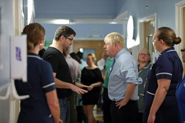 Boris Johnson being confronted by a parent