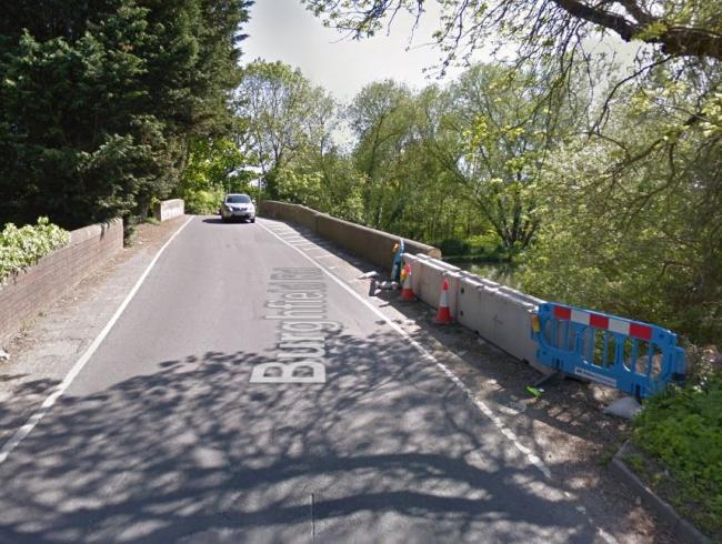 Man suffers head injury after car crashes into bridge