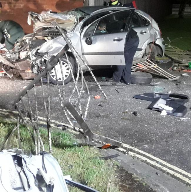 Driver hospitalised in Newbury after crashing through fence into wall