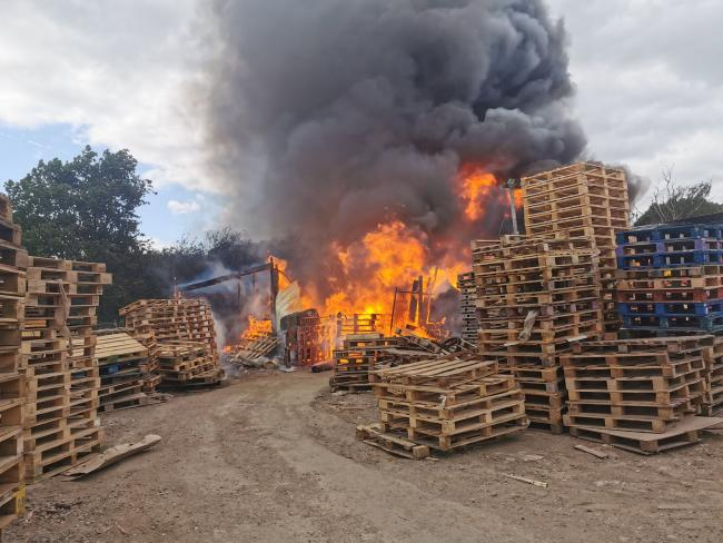 Crews scrambled to MAJOR fire engulfing wooden pallets at business site