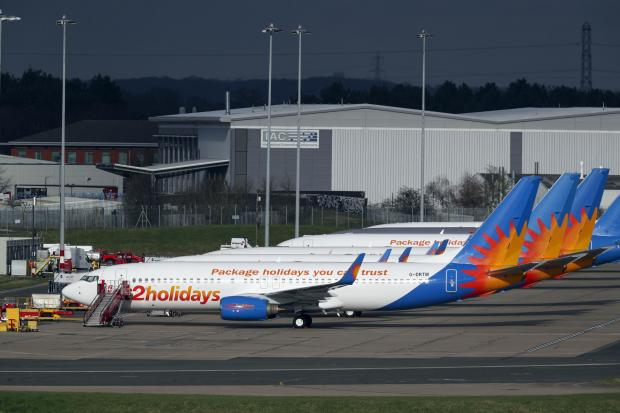 Reading Chronicle: AIRLINE: Several Jet2 planes have been parked up at Birmingham Airport during the pandemic. Picture: Steve Parsons/PA