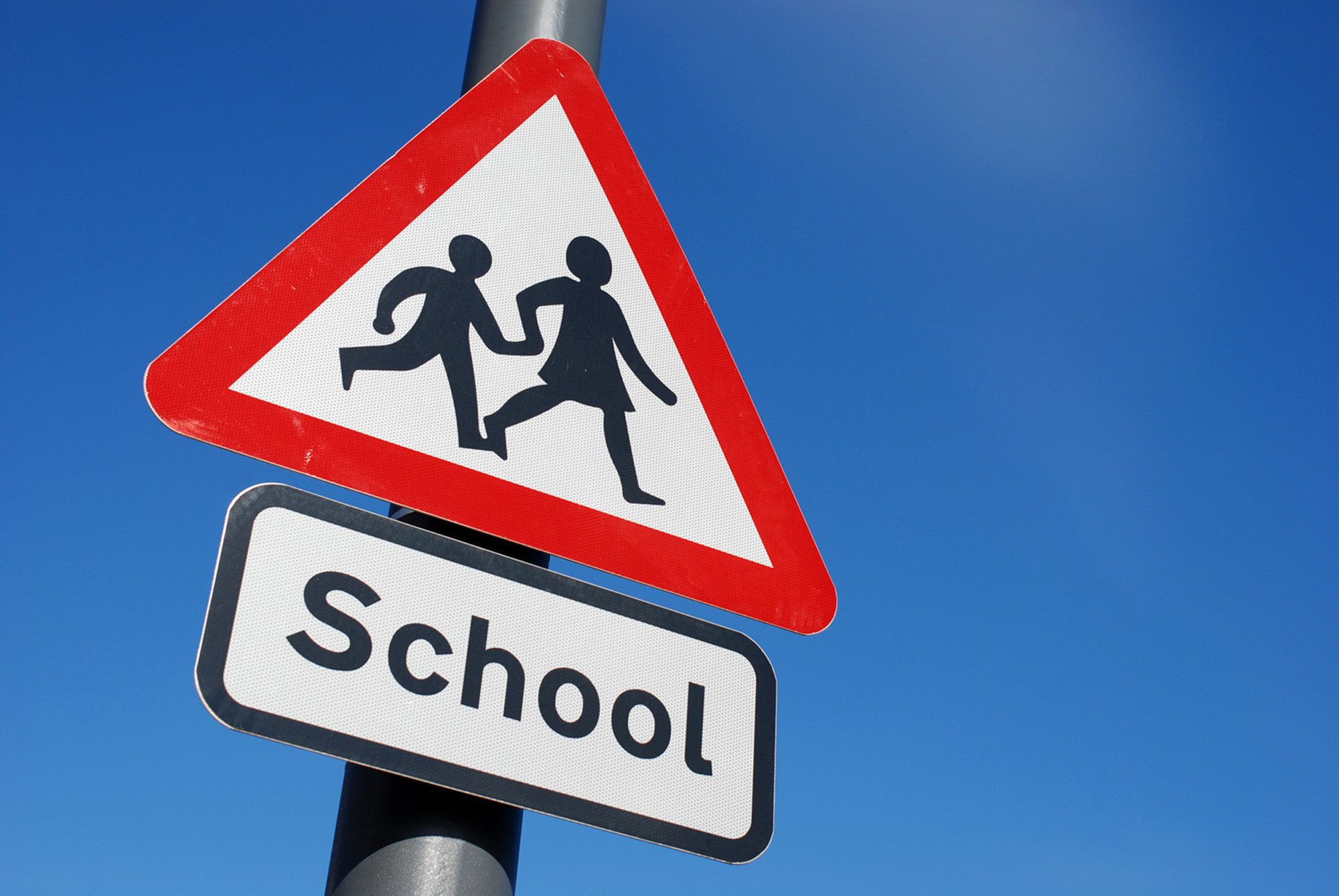 School children crossing sign with copy space.