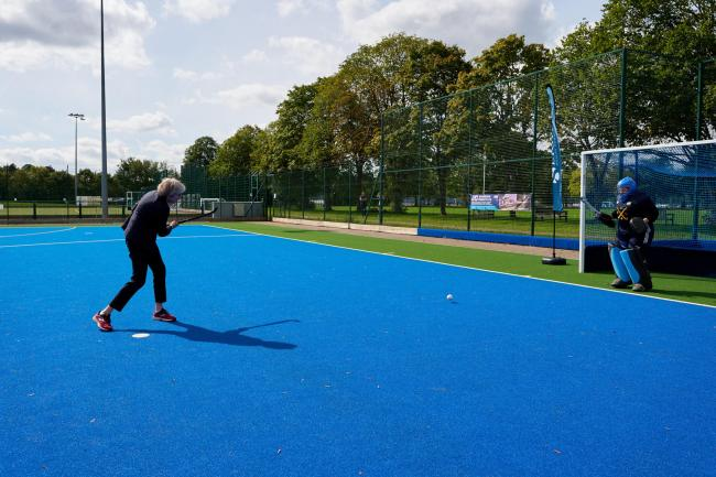 Theresa May scores first goal on Sonning Hockey Club's new pitch. Credit: Robert Pugh