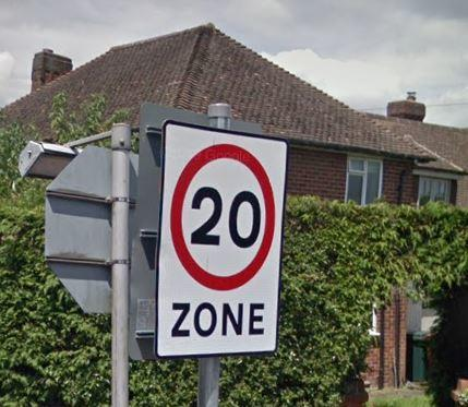 Resident plans to clean town's road signs for free