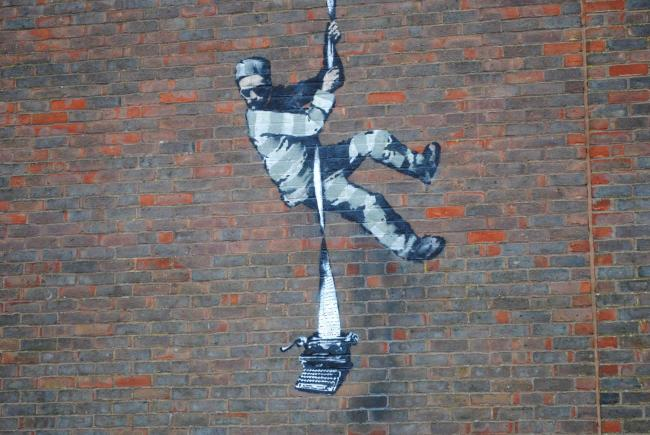 The Banksy mural on the wall of Reading Prison