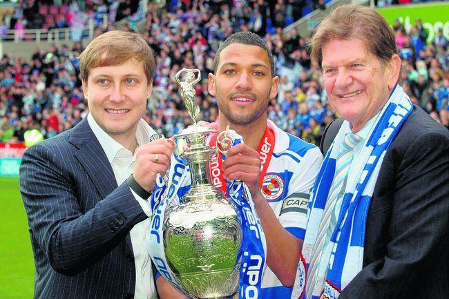 Jobi McAnuff with the 2012 Championship trophy plus former owner Anton Zingarevich, left, and ex-chairman, Sir John Madejski.