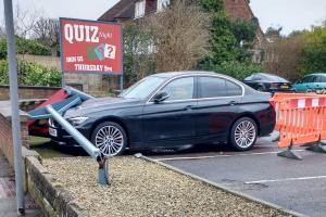 BMW hit by pub sign in strong winds