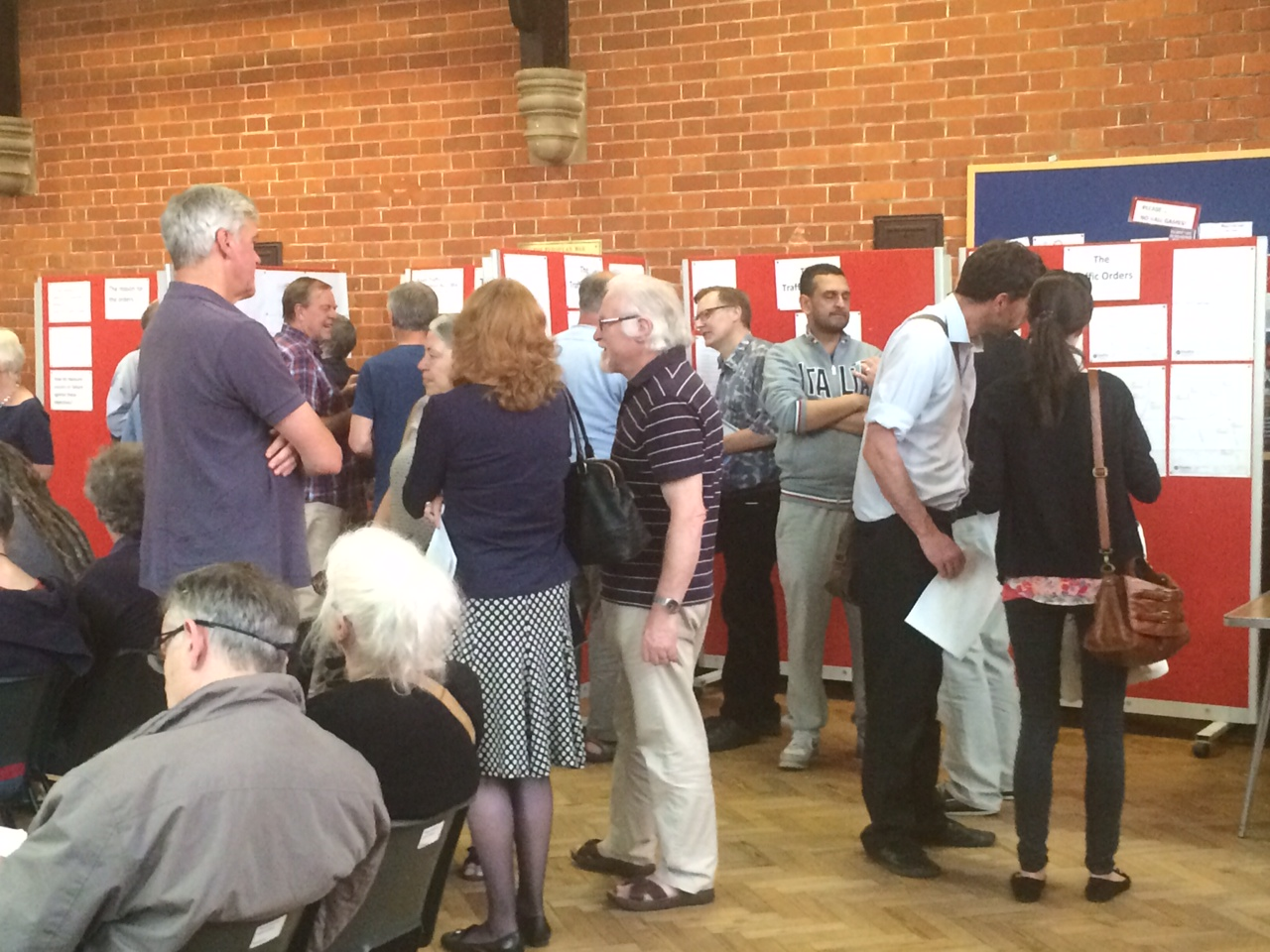 Residents peruse the proposed changes at the public meeting