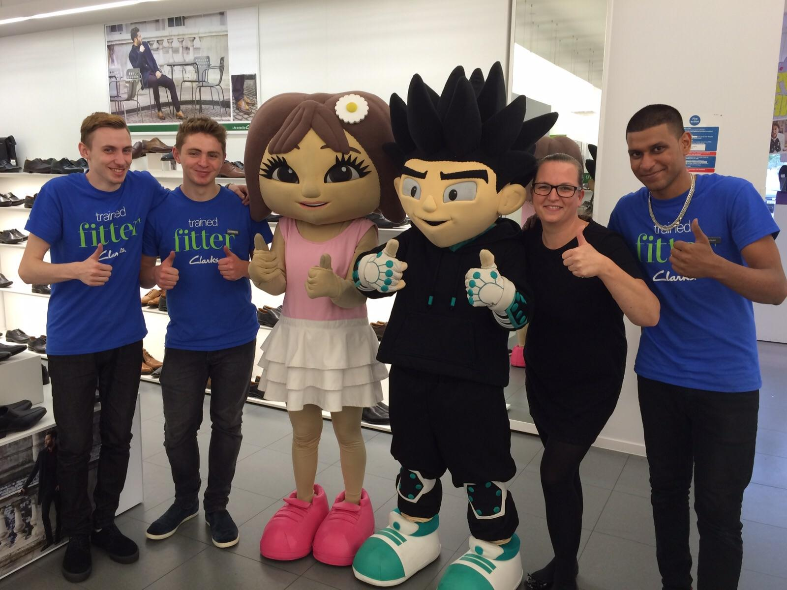The Retail Trust's mascots alongside some of the members they have supported.
