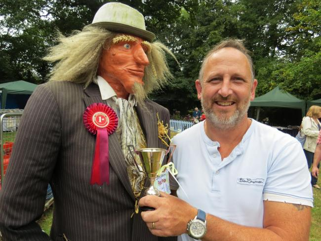 "Neil Maybury, with his trophy winning Worzel Gummidge scarecrow which sparked a ""dead body"" 999 emergency"