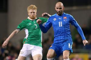 Reading's Paul McShane, left, in action for Republic of Ireland against Slovakia. Picture: Brian Lawless/PA Wire.