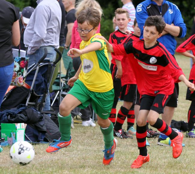 Elliot Moxmon makes a break for Laurel Park FC at the Woodly Saint's Football Festival