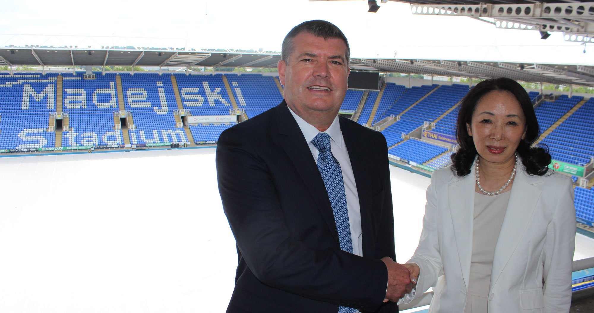 Ron Gourlay with Royals co-owner, Dai Xiu Li.