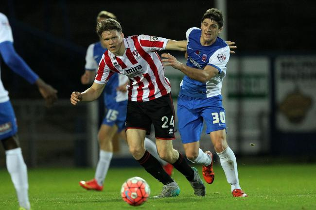 Rob Dickie, left, impresses on loan with Cheltenham Town. Picture: Mark Fletcher/Shutter Press.
