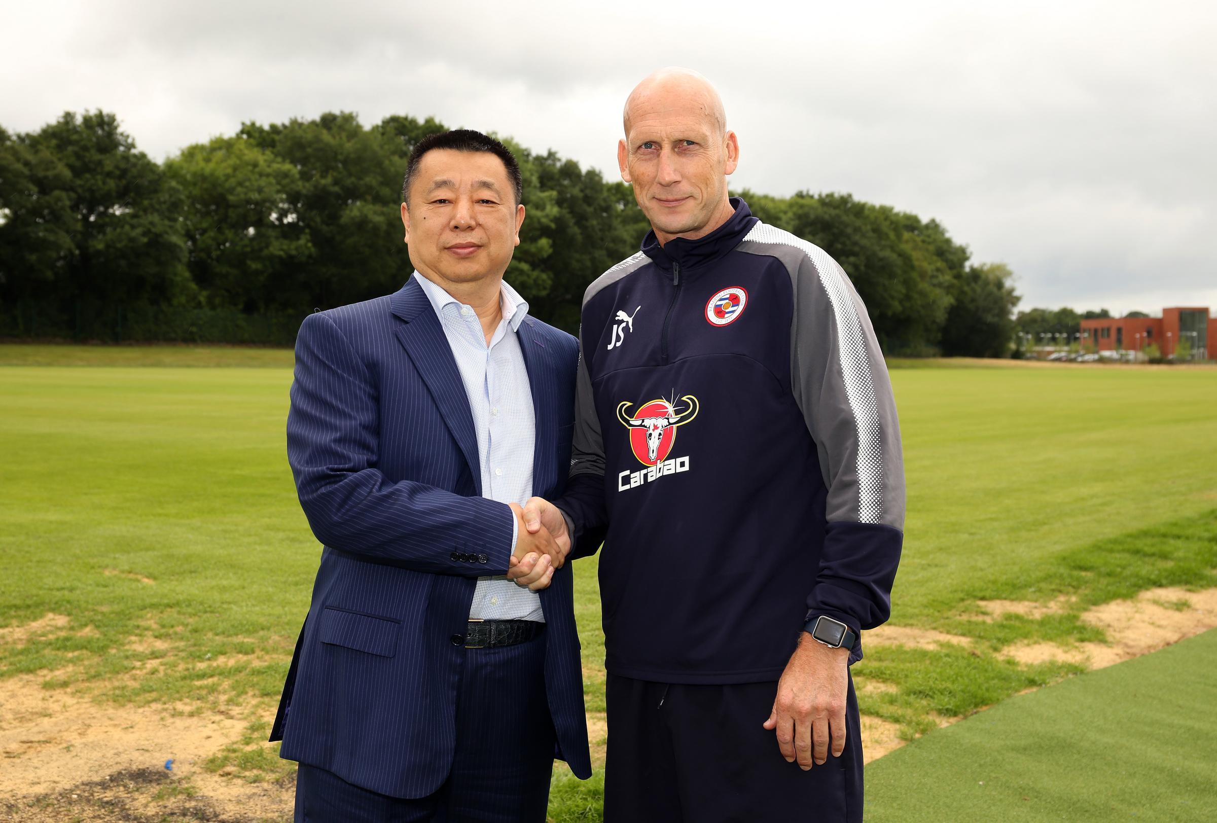 Reading FC joint owner, Dai Yongge, with manager Jaap Stam.