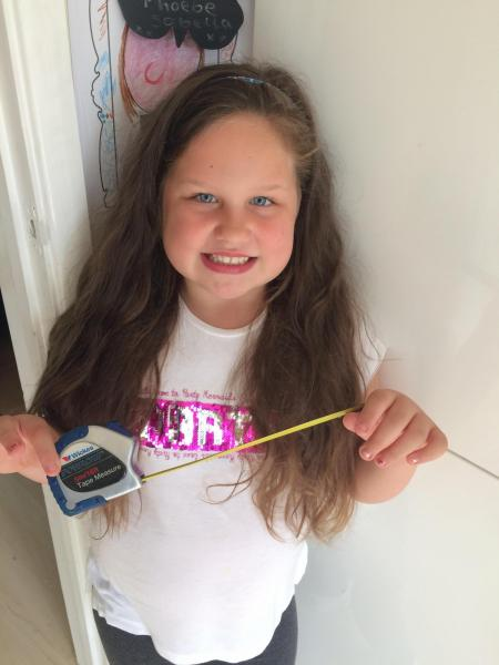 Persistent schoolgirl cuts 12 inches of hair for charity