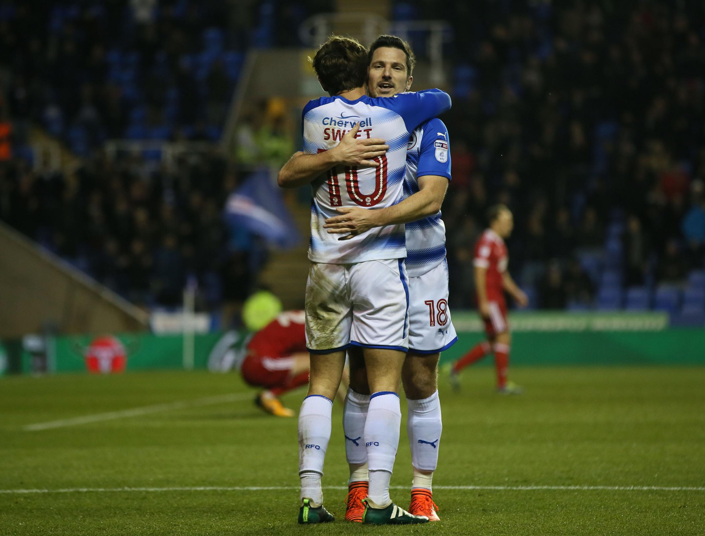 Yann Kermorgant, who signed a new deal today, hugs John Swift after last night's 3-1 win against Nottingham Forest. Picture: Ian Morsman.