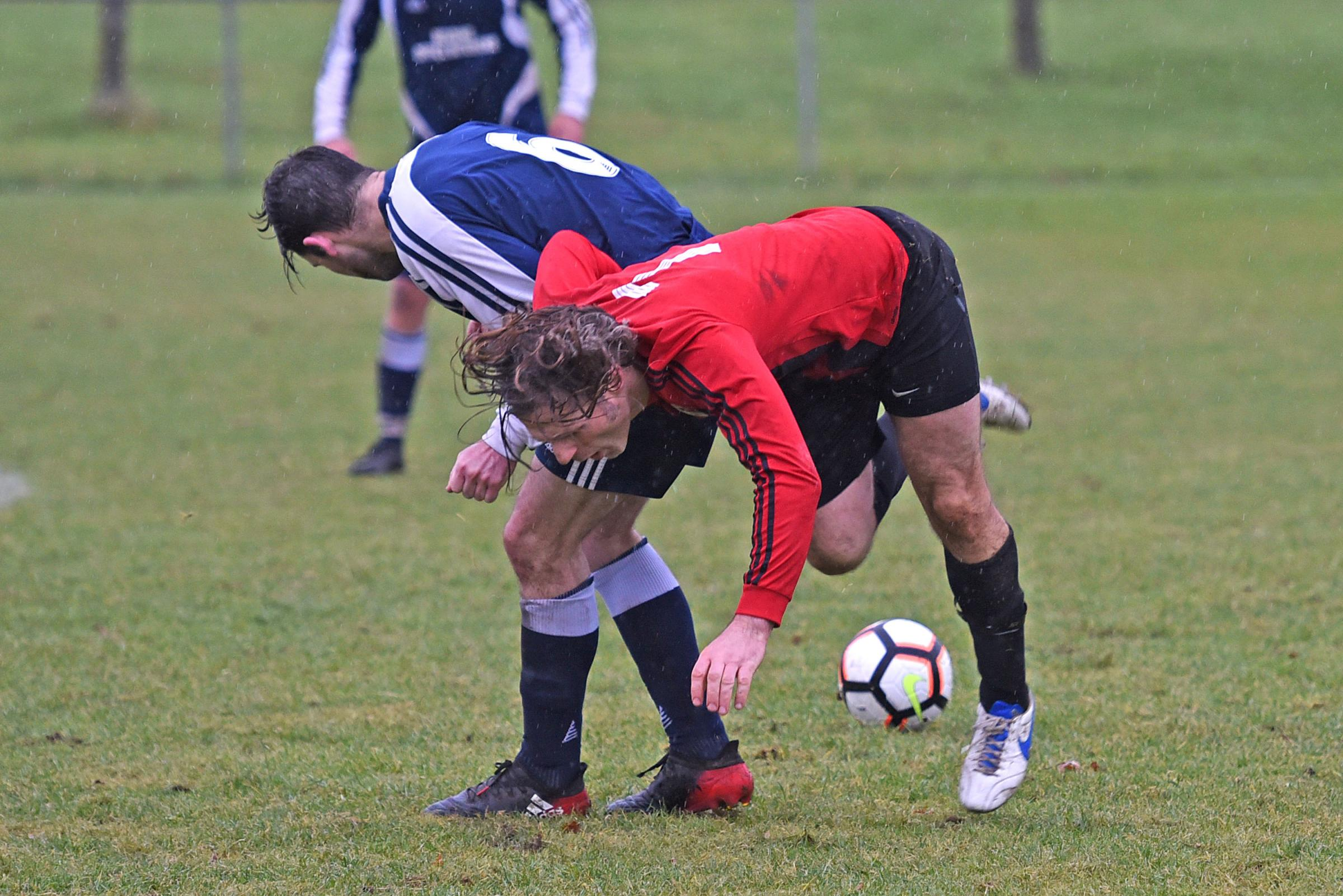 Wycombe Wanderers manager and Finchampstead Athletic player Gareth Ainsworth is sent sprawling by a Purley opponent. Pictures: Emma Sheppard. Code 171250.