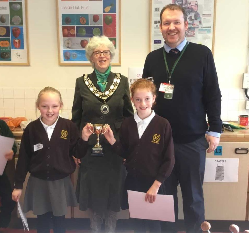 Winners Isabella and Annie from Rivermead Primary School, with Woodley Mayor Cllr Jenny Cheng and Highwood Primary School headteacher Matt Hickey