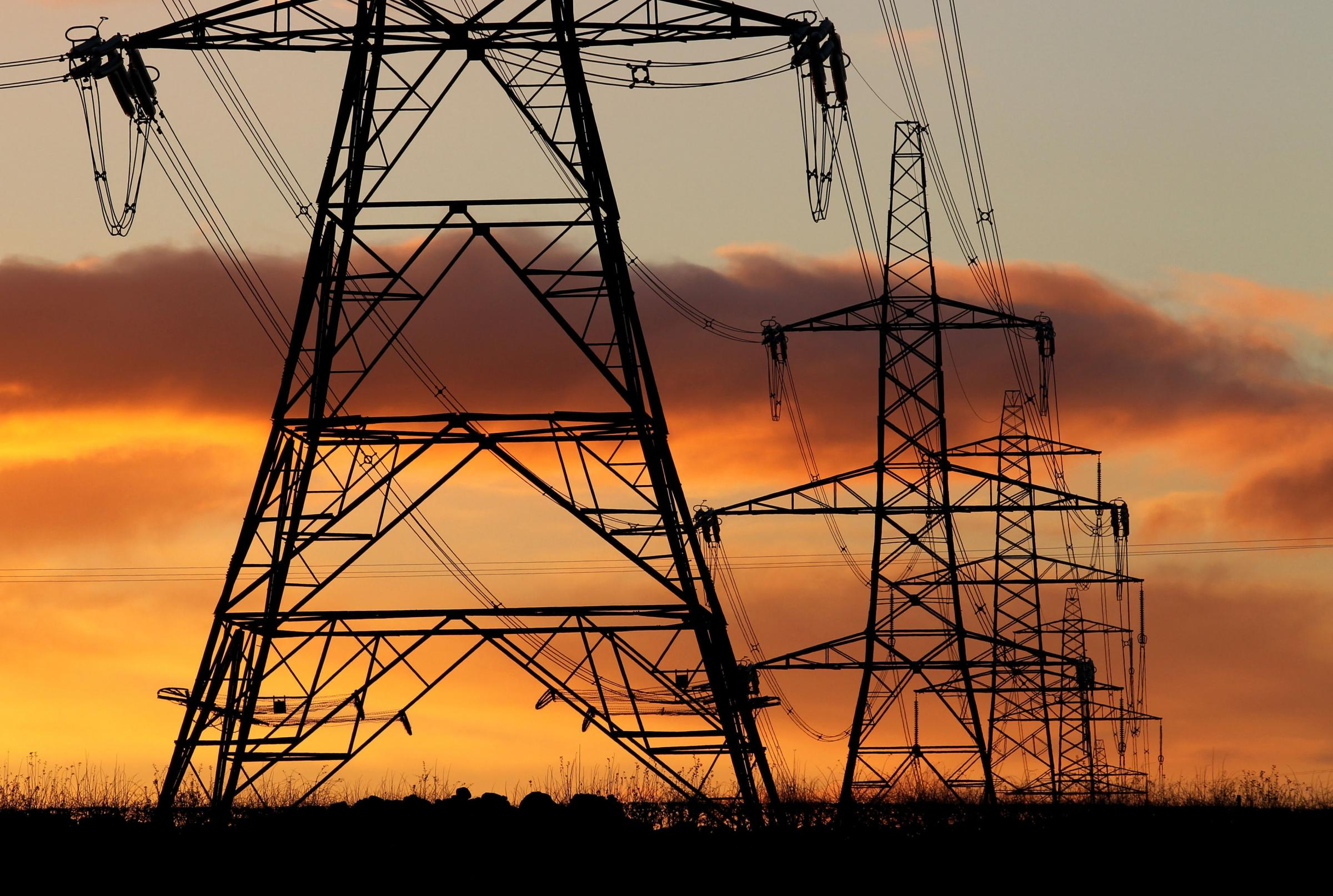 Embargoed to 0001 Friday April 27..File photo dated 24/11/10 of electricity pylons. UK households are overpaying for their electricity following Ofgem-set price controls that have resulted in excess profits for distribution companies, a charity has said.