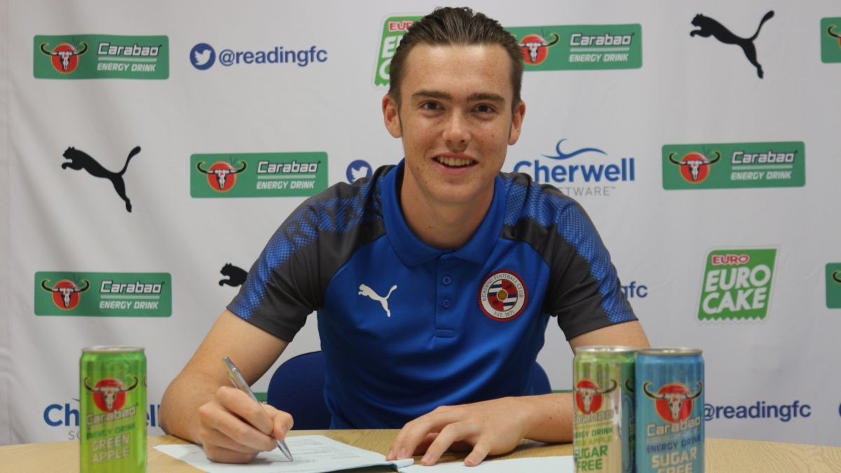 Jack Nolan signs his first contract - picture by Reading FC