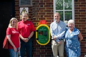 Community rallies to install defibrillator in man's memory