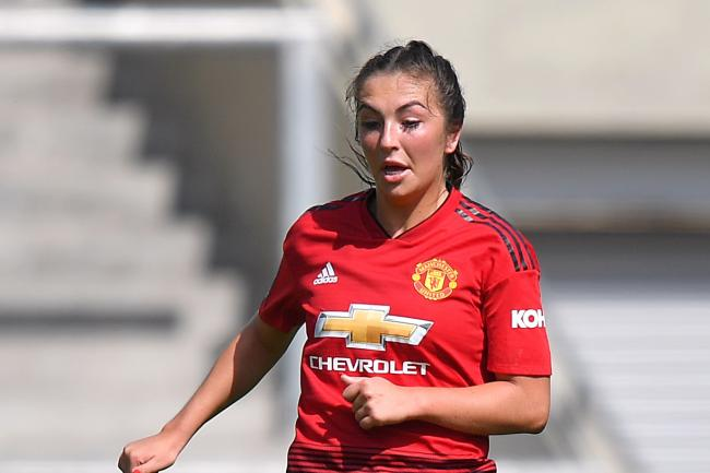 Katie Zelem scored a free-kick as Manchester United beat Manchester City 2-0