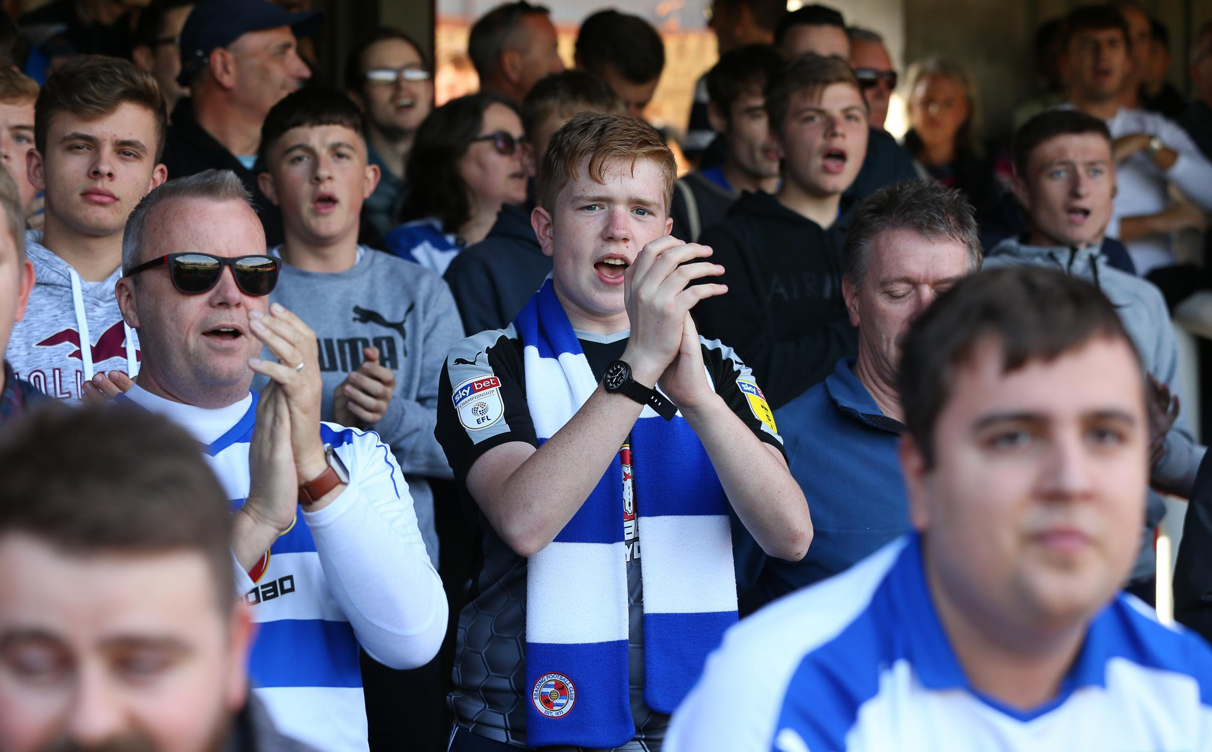 Reading FC fans cheering on the team - stock image