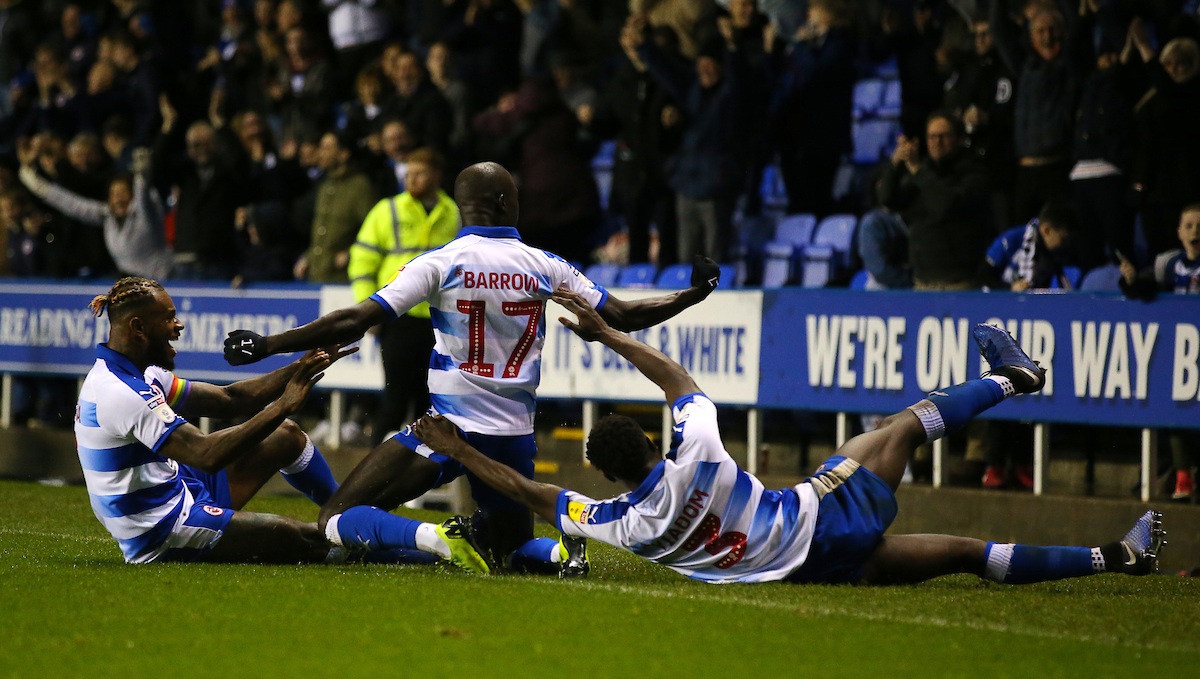 Mo Barrow is mobbed after scoring an injury-time equaliser against Stoke City.