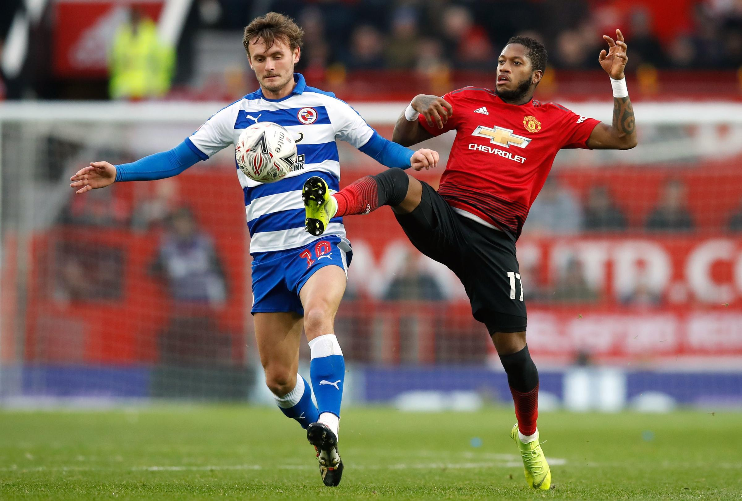 Reading's John Swift is challenged by Manchester United's Fred. Pictures: PA Sport.