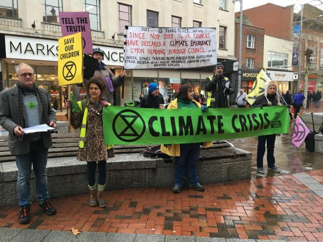 Extinction Rebellion Reading in Broad St collecting climate emergency petition signatures on January 19. The council declared a climate emergency in February.