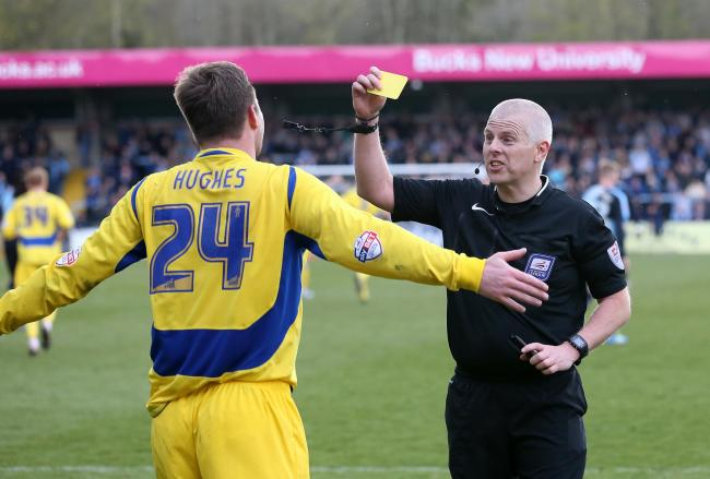 Mark Hughes of Accrington Stanley is given a yellow card for celebrating with the Accrington Stanley fans..during the  skybet league 2 Football match between Wycombe Wanderers and Accrington Stanley  at Adams park wycombe   on the 30th april 2016 Football