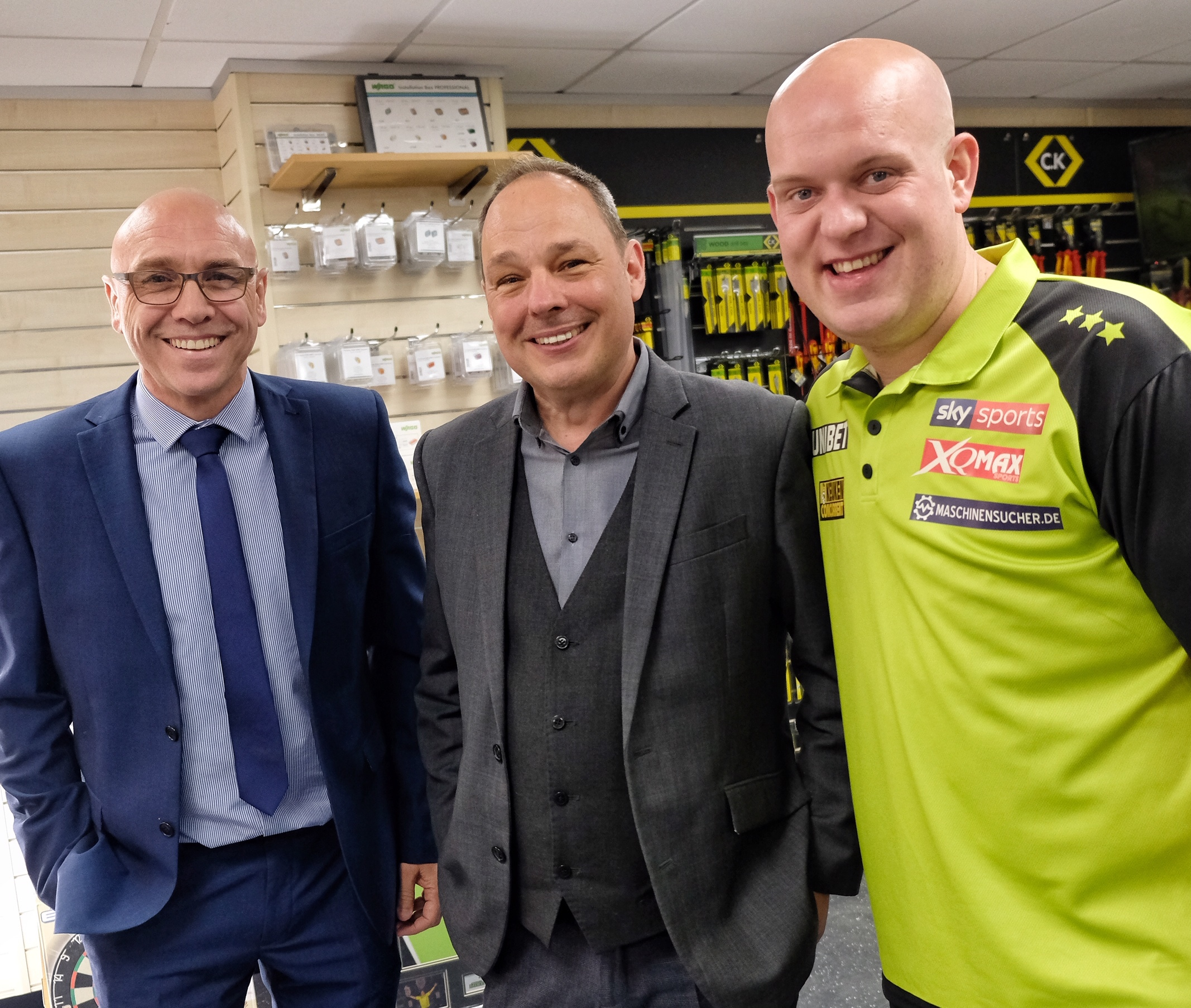 (190471) Jason Worm and Steve Sleep with Darts Champ Michael Van Gerwin who  visits Edmundson Electrical. Pictures by Mike Swift.