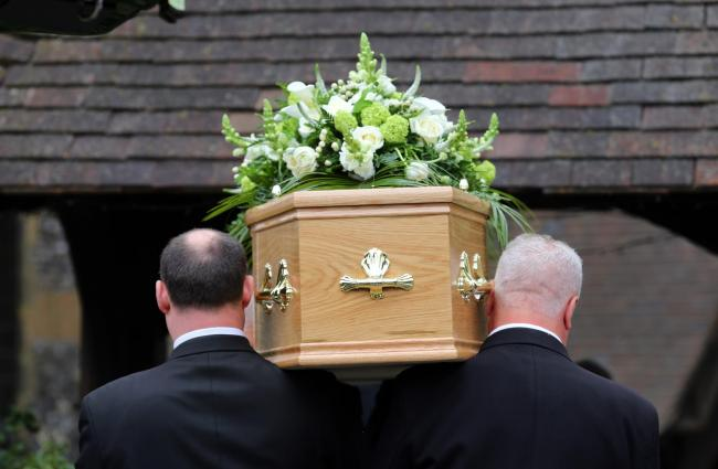 Undated file photo of a funeral taking place. Councils collectively spent £6.3 million on so-called paupers' funerals in 2018/19, according to calculations.
