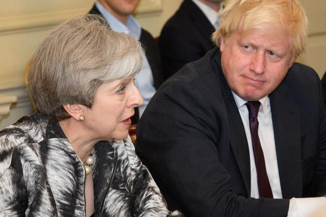 File photo dated 12/06/17 of Prime Minister Theresa May with Foreign Secretary Boris Johnson, as she held the first Cabinet meeting since the General Election with her reshuffled team. The Prime Minister is expected to announce details later today of her