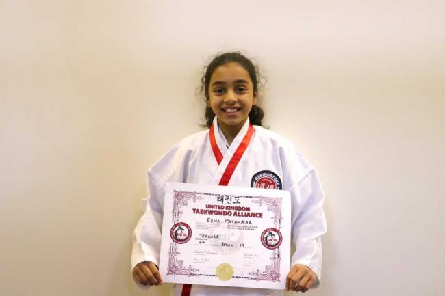 Esha, 11, has passed a qualifcation to become an instructor