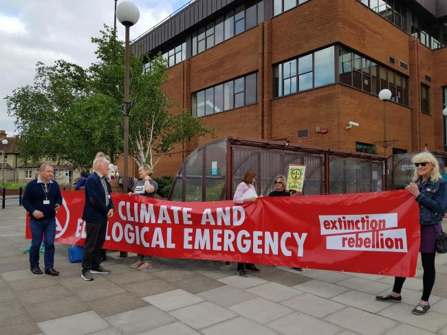 Climate crisis protestors outside the council