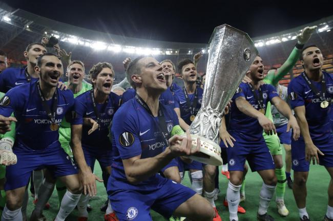 Chelsea's captain Cesar Azpilicueta celebrates with the trophy after winning the Europa League Final soccer match between Arsenal and Chelsea at the Olympic stadium in Baku, Azerbaijan, Thursday, May 30, 2019. Chelsea won 4-1. (AP Photo/Luca Bruno).