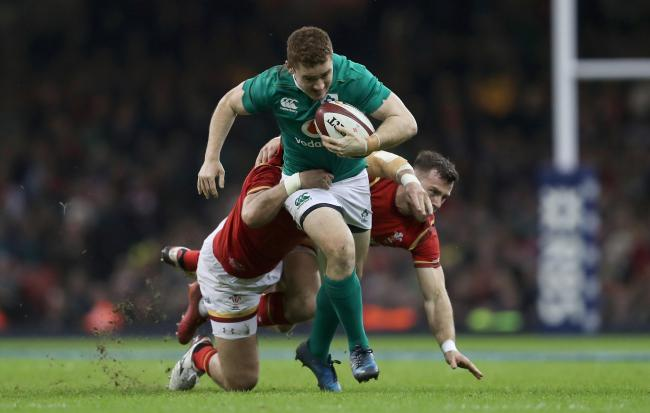 Ireland's Paddy Jackson (centre) is tackled by Wales' Scott Baldwin and Gareth Davies (right) during the RBS Six Nations at the Principality Stadium, Cardiff. PRESS ASSOCIATION Photo. Picture date: Friday March 10, 2017. See PA story RUGBYU Wales.